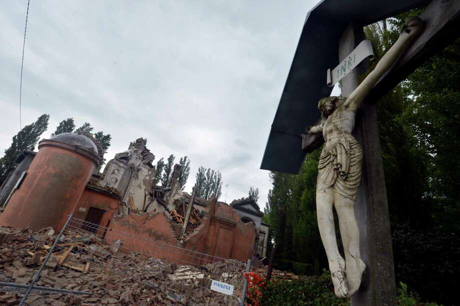 The destroyed church in San Carlo, Italy, is seen Monday following an earthquake the day before. Several thousand Italians spent the night in cars or temporary shelters after a strong earthquake hit the northeast Sunday, killing six people and reducing homes and historic buildings to rubble.         (GIUSEPPE CACACE/AFP/GettyImages) Photo: GIUSEPPE CACACE, AFP/Getty Images / 2012 AFP
