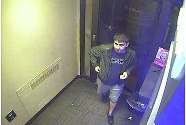 New Canaan Police released this surveillance footage of Adrian Abagiu, the Bronx, N.Y., man facing multiple charges for attempting to install an ATM skimming device at Chase Bank in New Canaan, May 18, 2012. Photo: Contributed Photo
