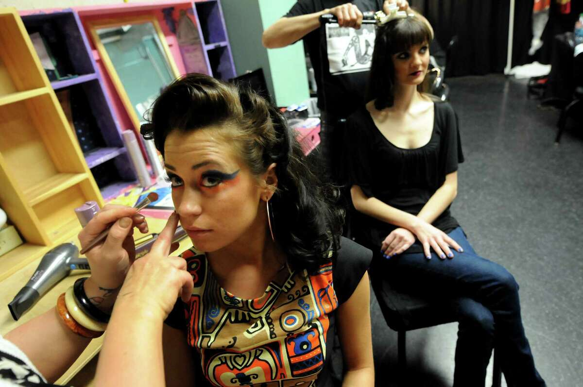 Model Stephanie Curtis, left, gets a touch up on her makeup while hair model Kristen Sorbaro gets her hair prepped in the dressing room for the show to begin during the Electric City Couture on Friday, May 18, 2012, at the GE Theatre at Proctors in Schenectady, N.Y. (Cindy Schultz / Times Union)