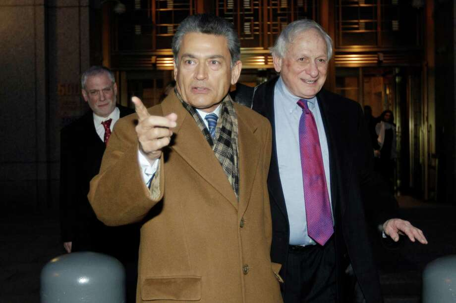 FILE- In this Jan. 5, 2012 file photo, former Goldman Sachs board member Rajat Gupta, left, exits Manhattan federal court with his attorney Gary Naftalis, in New York. The insider trading trial of the former board member for Goldman Sachs and Procter & Gamble begins in New York on Monday, May 21, 2012, with jury selection. (AP Photo/Mary Altaffer, File) Photo: Mary Altaffer, AP / 2012 AP