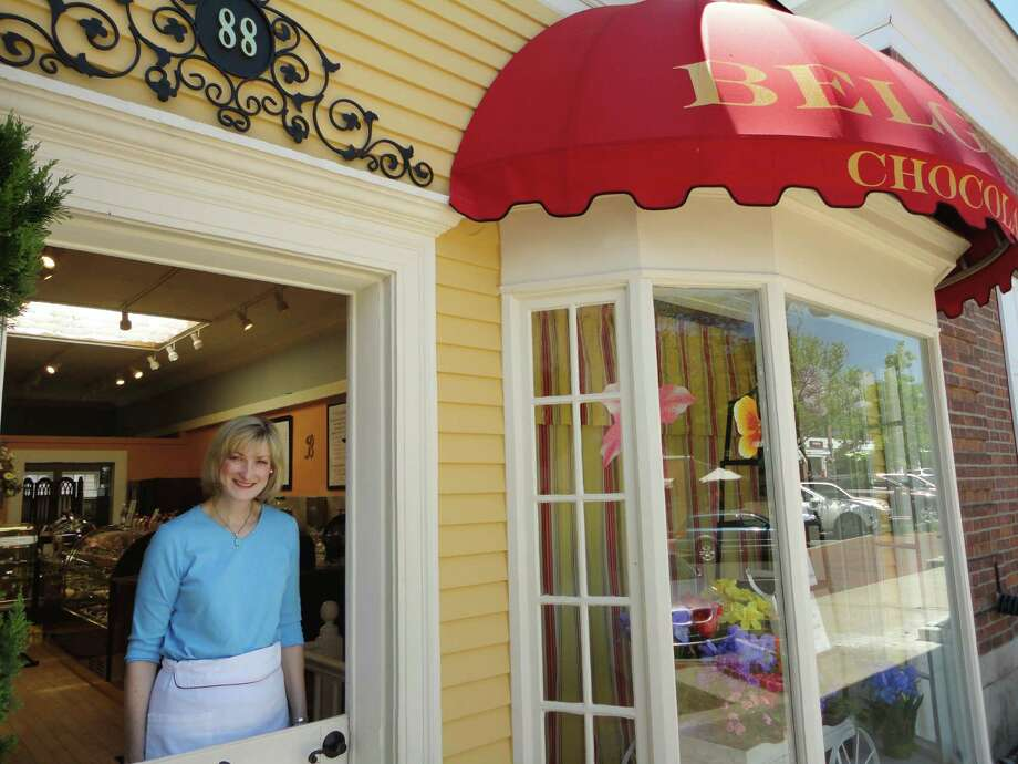 Susan Gilissen, co-owner of Belgique Chocolatier in New Canaan, Conn. in her shop on Elm Street on Sunday, May 20, 2012. Gilissen's husband, Pierre Gilissen is the chef/chocolate maker for their business. Photo: Meg Barone / Stamford Advocate Freelance