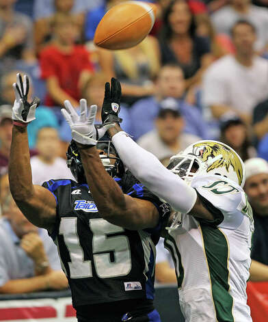 A touchdown pass floats down into the hands of Jomo Wilson who beats Ruschard Dodd-Masters in the second quarter as the San antonio Talons play the San Jose Sabercats  on May 19, 2012.  Tom Reel/ San Antonio Express-News Photo: TOM REEL, Express-News / San Antonio Express-News