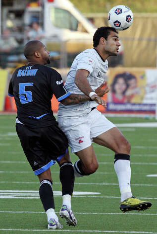 Scorpions' Pablo Campos heads the ball around FC Edmonton's Kevin Hatchi during first half action Saturday May 19, 2012 at Heroes Stadium. Photo: EDWARD A. ORNELAS, Express-News / © SAN ANTONIO EXPRESS-NEWS (NFS)