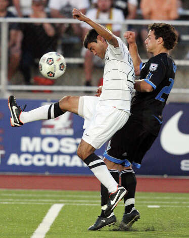 Scorpions' Javier Saavedra (left) and FC Edmonton's Antonio Rago go up for the ball during first half action Saturday May 19, 2012 at Heroes Stadium. Photo: EDWARD A. ORNELAS, Express-News / © SAN ANTONIO EXPRESS-NEWS (NFS)