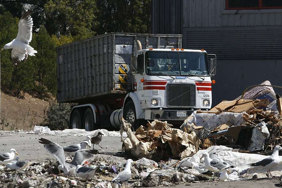 "A garbage trucks with Recology, San Francisco trash collection service, prepares to dump a load of trash at the Transfer station, nick named ""The Pit"", on Friday Sep. 11, 2009 in San Francisco, Calif. Recology is now talking about changing there landfill location to Yuba County - located about 40 miles north of Sacramento. Photo: Mike Kepka, The Chronicle"