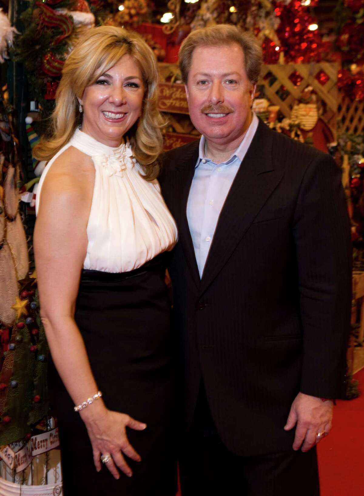 Denise and Sam Malone pose for a photo during the Nutcracker Market preview party at Reliant Center Wednesday, Nov. 10, 2010, in Houston. ( Brett Coomer / Houston Chronicle )