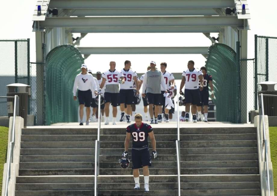 MONDAY, MAY 21 Houston Texans defensive end J.J. Watt (99) walks to practice with his teammates Monday for the start of organized team activities. (Brett Coomer / Houston Chronicle)