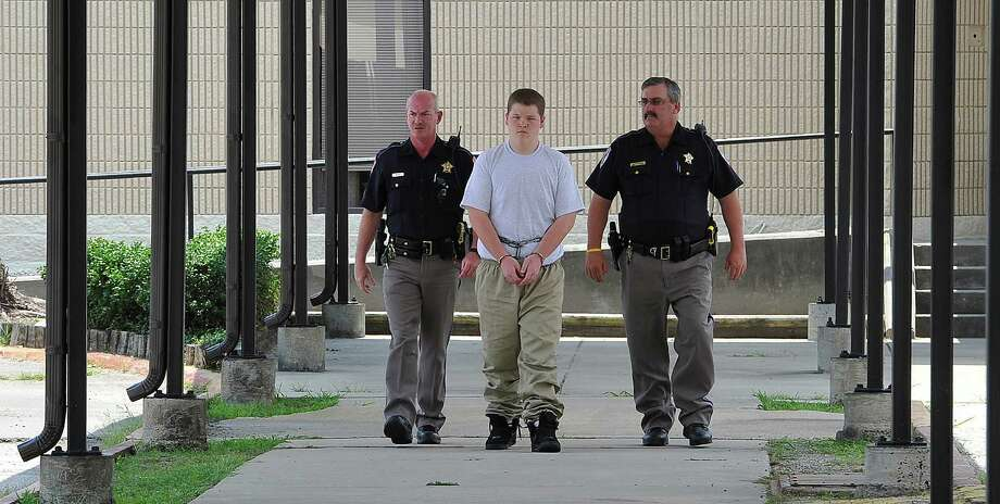 Orange County Sheriff deputies,  Harry Meaux, left, and Scott Barnes, right, escort Orange county teen, Braeden Richter, middle,15, who was charged with murder in connection with the May 2011 shooting death of Charles Henry Southard to the 260th District Court. He was sentenced to 30 years Monday, May 21, 2012.  Dave Ryan/The Enterprise