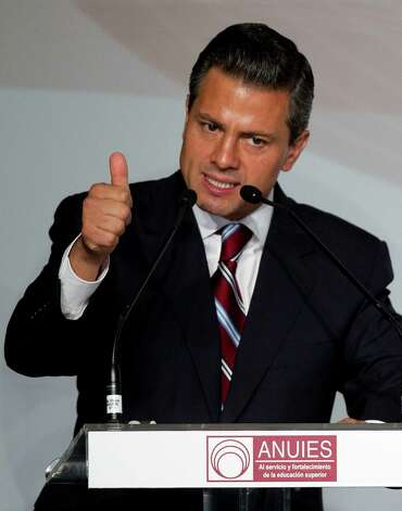 Enrique Pena Nieto, presidential candidate for the Institutional Revolutionary Party (PRI), speaks during a meeting with Mexican universities rectors in Mexico, Monday,  May 21, 2012. Pena Nieto, the front-running candidate in the race for Mexico's July 1 presidential election, is pledging to respect transparency and plurality if elected, things his Institutional Revolutionary Party was not known for during 71 years in power. Photo: AP