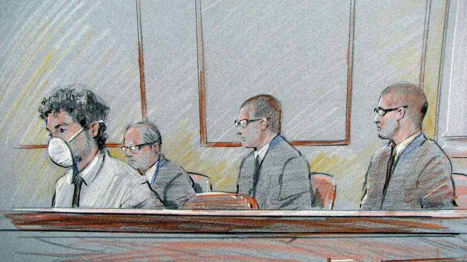Pfc. Naser Abdo watches courtroom proceedings during the first day of his trial while courthouse security officers wearing protective goggles sit a few feet away.  Abdo is wearing it after reportedly spitting at a federal agent. Sketch by Gary Myrick
