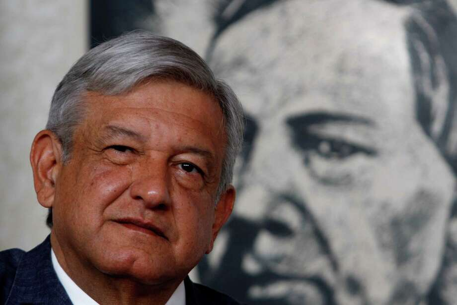 In this Friday, April 13, 2012 file photo, Manuel Lopez Obrador, presidential candidate for the Democratic Revolution Party, PRD, is backdropped by a painting of Benito Juarez, Mexico's first president of Indian descent and national hero, while speaking at a news conference in Mexico City. For a man whose anger and inflexibility may have cost him his dreams of the presidency, leftist candidate Andres Manuel Lopez Obrador is surprisingly calm and friendly on the campaign trail. Mexico will hold presidential elections on July 1, 2012. Photo: AP