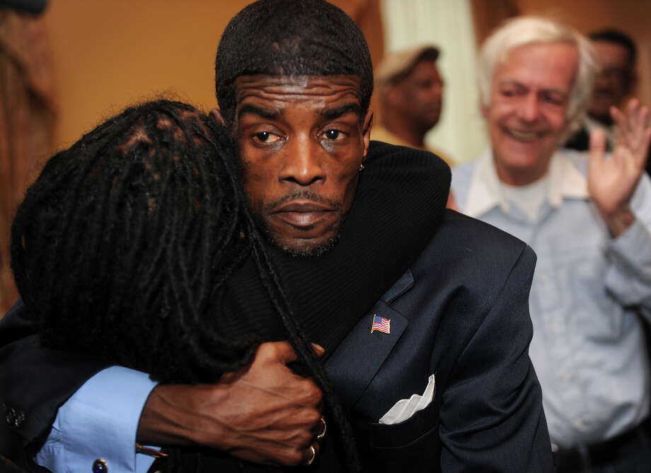 Ernest Newton is hugged by his sister, Patty Newton-Foster, after winning the Democratic nomination for state Senate at Testo's restaurant in Bridgeport on Monday, May 21, 2012. Photo: Brian A. Pounds / Connecticut Post