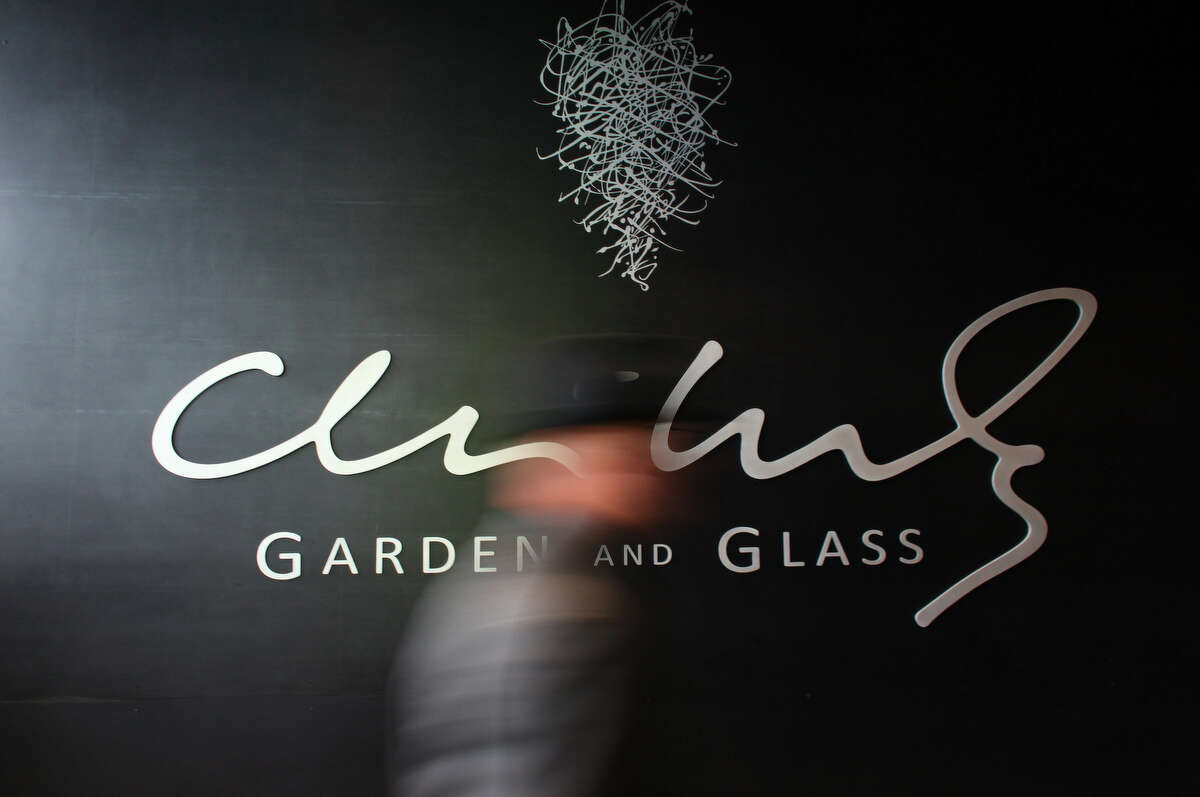 A visitor is blurred as he walks into the gallery during the grand opening of the Dale Chihuly Garden and Glass museum.