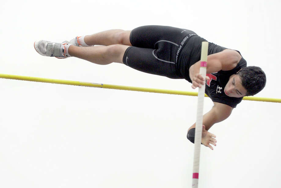 Tim Murphy of New Fairfield competes in the pole vault at the SWC track and field championships at Bethel High School, Monday, May 21, 2012. Photo: Carol Kaliff / The News-Times