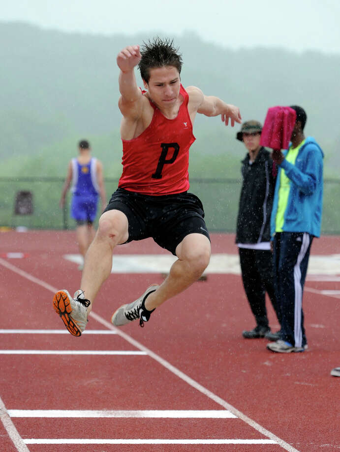 Jonathan Novitski of Pomperaug High School competes in the long jump at the SWC field and track championships at Bethel High School, Monday, May 21, 2012. Photo: Carol Kaliff