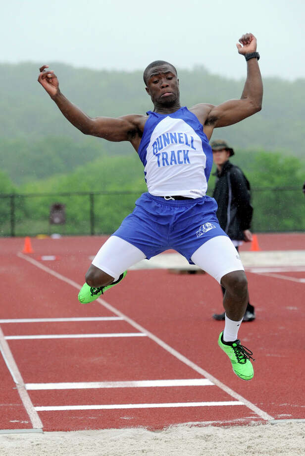 David Camille of Bunnell High School competes in the long jump at the SWC field and track championships at Bethel High School, Monday, May 21, 2012. Photo: Carol Kaliff