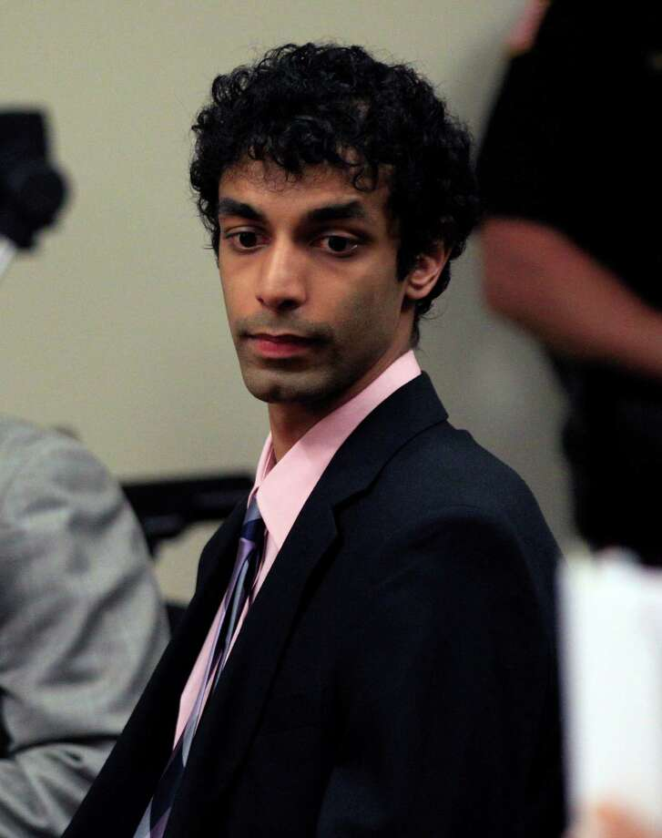 Dharun Ravi sits in court during his sentencing in New Brunswick, N.J., Monday, May 21, 2012. Ravi, a former Rutgers University student who used a webcam to watch his roommate kiss another man days before the roommate killed himself, was sentenced Monday to 30 days in jail. A judge also gave 20-year-old Dharun Ravi three years of probation. (AP Photo/MelEvans) Photo: Mel Evans / AP