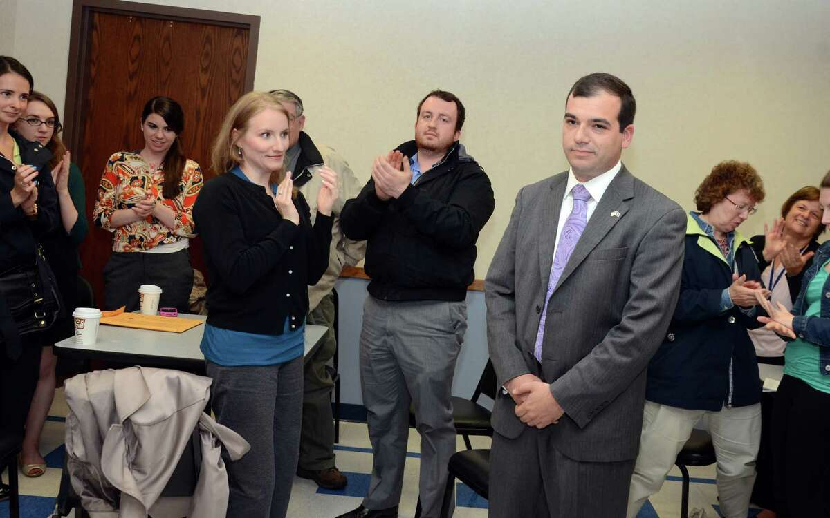 Kristen Giammarinaro, of Stamford and Jonathan Winkel, of Stamford, applaud for Daniel Dauplaise democratic nominee for the 36th state senate district in the Cone Room at Greenwich Town Hall on Monday, May 21, 2012.