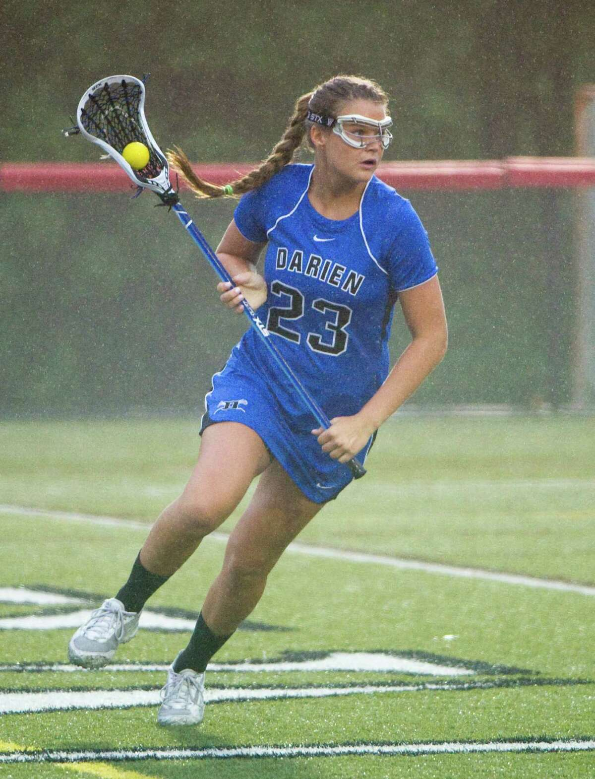 Dairne's Charlett Stevenson in action as New Canaan and Darien face off in the FCIAC Girls Lacrosse Semifinals at Dunning Field in New Canaan, Conn., May 21, 2012.