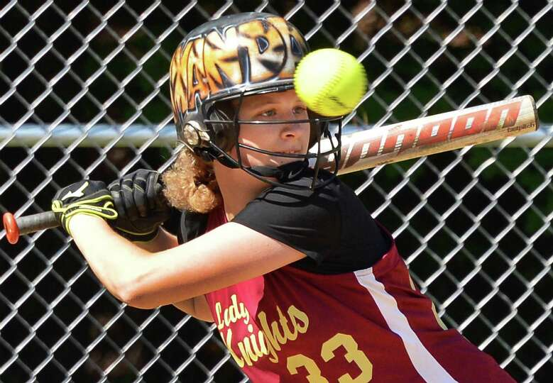 Bishop Gibbons' Amanda Methe takes a high ball before getting a hit on the next pitch in Saturday's