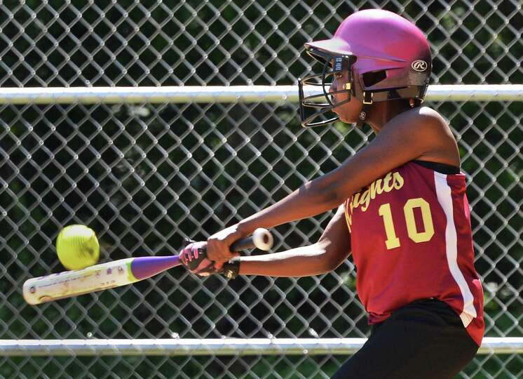 Bishop Gibbons'  Nessa Wilson gets a hit in Saturday's game with Albany High in Schenectady May 19,