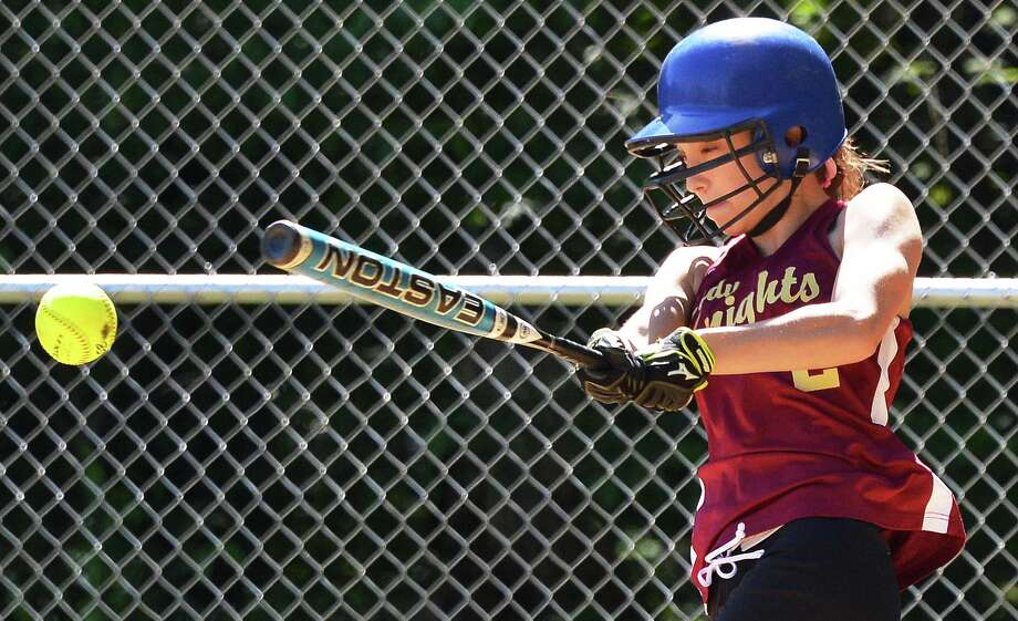 Bishop Gibbons' Caroline Bouchard makes contact during Saturday's game with Albany High in Schenectady May 19, 2012.   (John Carl D'Annibale / Times Union) Photo: John Carl D'Annibale / 00017719A