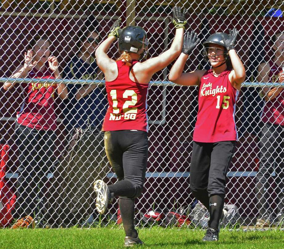 Bishop Gibbons' Anna Grace Maggs, left, is congratulated by team mate Joelle Salisbury after hitting a home run in Saturday's game with Albany High in Schenectady May 19, 2012.   (John Carl D'Annibale / Times Union) Photo: John Carl D'Annibale / 00017719A