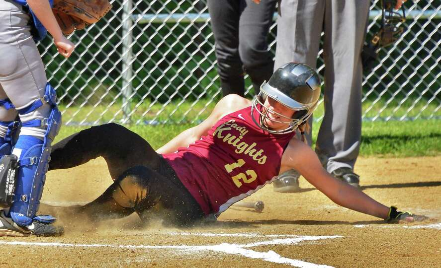 Bishop Gibbons' Anna Grace Maggs slides home after hitting a home run in Saturday's game with Albany