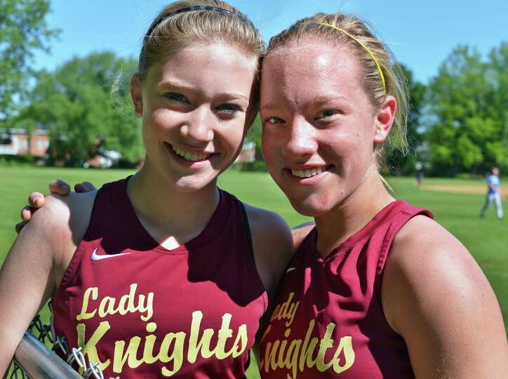 Bishop Gibbons team mates and sisters Lilly, left, and Anna Grace Maggs pose for a photo before Satu