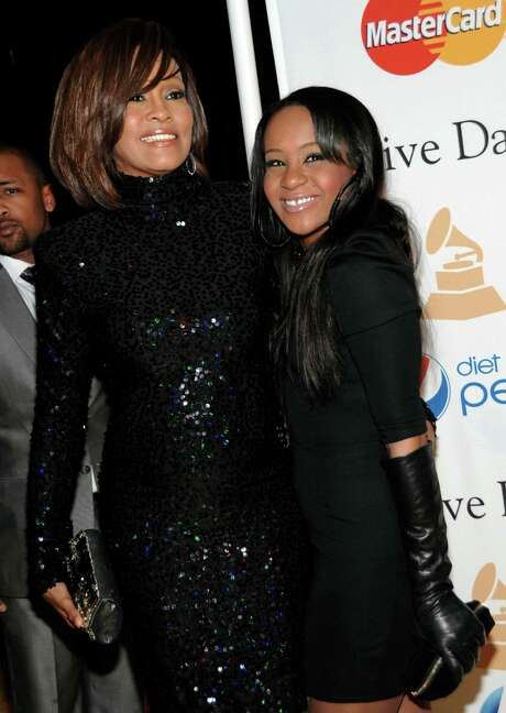 """FILE - In this Feb. 12, 2011 file photo, singer Whitney Houston, left, and her daughter Bobbi Kristina arrive at the Pre-Grammy Gala & Salute to Industry Icons with Clive Davis honoring David Geffen in Beverly Hills, Calif. A reality show featuring Whitney Houston's relatives, including daughter Bobbi Kristina and mother Cissy, is in the works. Houston rep Kristen Foster confirmed the Lifetime show """"The Houston Family Chronicles"""" on Friday, May 11, 2012. Houston drowned in a bathtub in February at age 48, a death that was complicated by cocaine use. Photo: AP"""