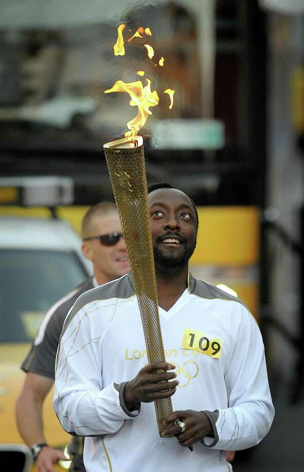 """I moonwalked on the torch run,"" said Will.i.am of the Black Eyed Peas as he carried the Olympic Flame. Photo: Tim Ireland / PA"