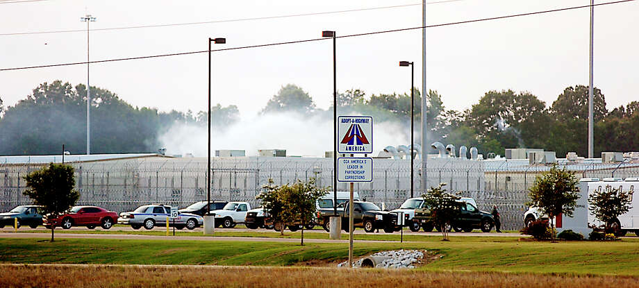 Tear gas rises above the Adams County Correctional Center in Natchez, Miss.,  during an inmate disturbance. Photo: Lauren Wood / AP