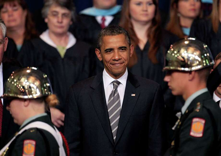 President Barack Obama watches a junior ROTC honor guard during commencement ceremonies at Joplin High School Monday, May 21, 2012, in Joplin, Mo. Seniors at the school finished their high school education in a converted big-box store after the old high school was destroyed by an EF-5 tornado that killed 161 people on graduation day a year ago. Photo: Charlie Riedel