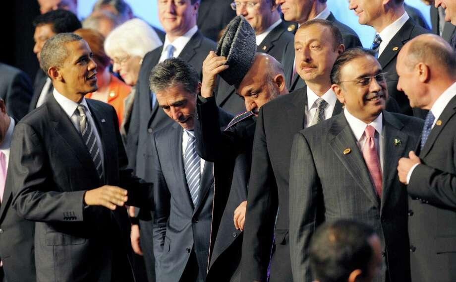 President Barack Obama, NATO Secretary-General Anders Fogh Rasmussen, Afghan President Hamid Karzai, Azerbaijani President Ilham Aliyev and Pakistani President Asif Ali Zardari gather for a photo. Photo: PHILIPPE WOJAZER / AFP