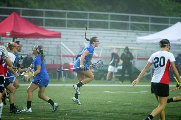 Darien's Brynn Gasparino reacts to a goal as New Canaan and Darien face off in the FCIAC Girls Lacrosse Semifinals at Dunning Field in New Canaan, Conn., May 21, 2012. Photo: Keelin Daly / Stamford Advocate