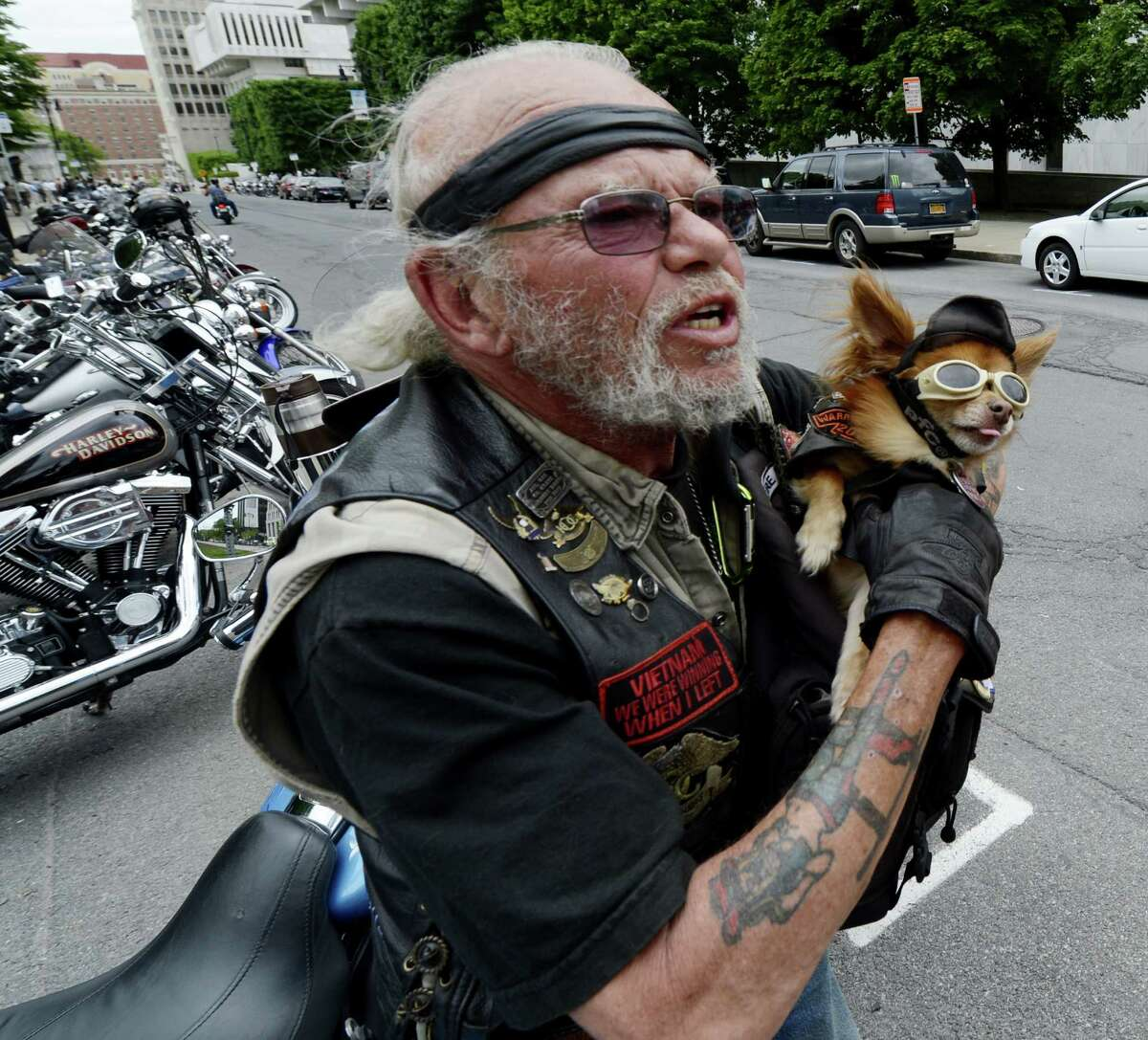 Anti-Helmut Law demonstrator Robert Shoemaker holds his dog Oso as he joins approximately 250 anti-helmet Law demonstrators descended on the State Capitol in Albany, N.Y. today May 21, 2012. (Skip Dickstein / Times Union)