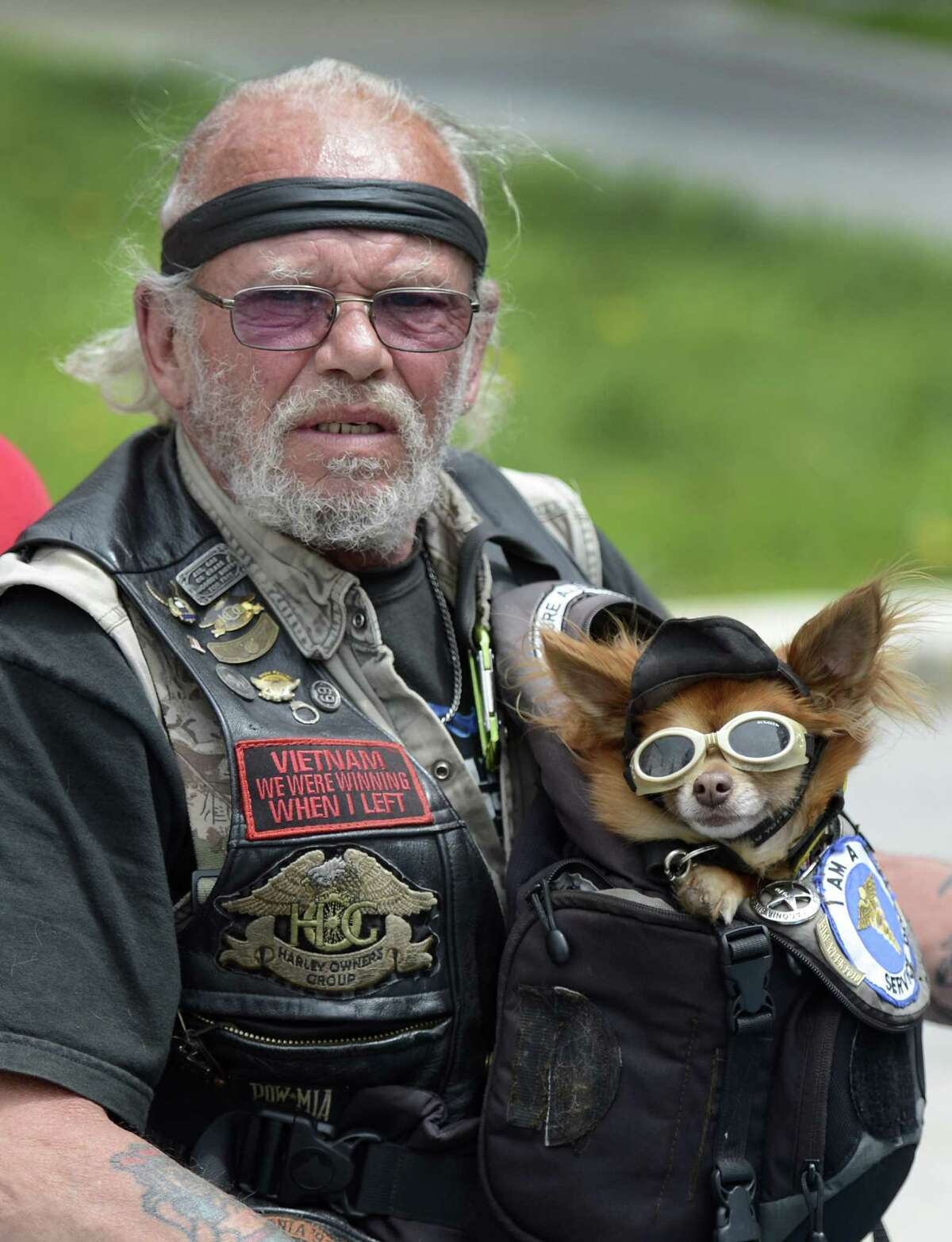 Robert Shoemaker holds his dog Oso and joined approximately 250 anti-helmet law demonstrators who descended on the state capitol in Albany, N.Y., May 21, 2012. (Skip Dickstein / Times Union)