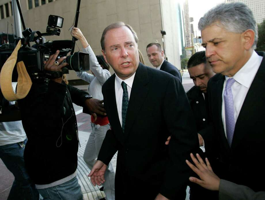 FILE - In this Oct. 23, 2006, file photo former Enron CEO Jeff Skilling, left,  leaves the federal courthouse with his attorney Daniel Petrocelli, right, after being sentenced to 292 months in federal prison. A federal appeals court on Monday, Nov. 1, 2010, will consider whether Skilling should get a new trial following a high court ruling that his conviction was flawed. Skilling was convicted of conspiracy, securities fraud, insider trading and lying to auditors. (AP Photo/David J. Phillip, File) Photo: DAVID J. PHILLIP / AP