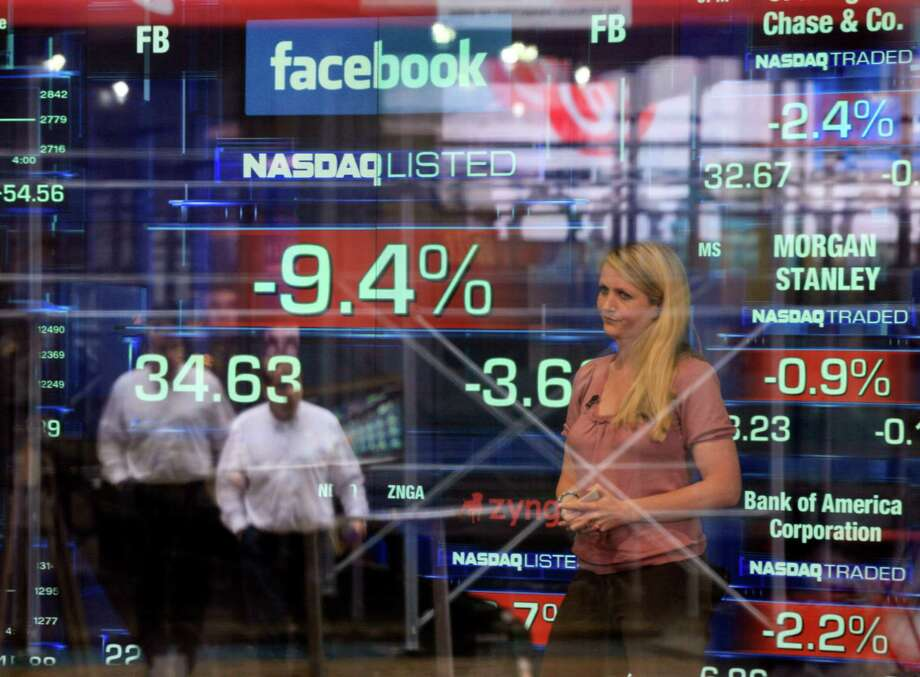 Television correspondent Sabrina Quagliozzi reports Monday from inside the Nasdaq MarketSite in New York's Times Square as Facebook's shares sink. Photo: Richard Drew / AP