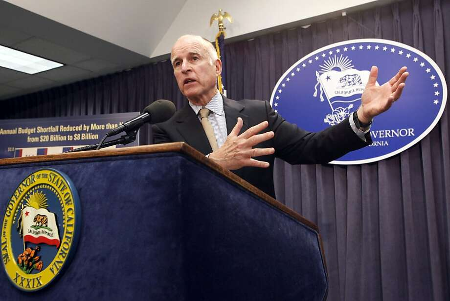 Gov. Jerry Brown releases details of his revised budget plan for the coming fiscal year just days after saying California faces a $16 billion deficit, almost double what he had predicted in January. Closing that shortfall would require cutting spending by an amount equal to roughly 17 percent of the state's general fund, but the Democratic governor is seeking a combination of cuts and tax hikes instead. (AP Photo/Nick Ut) Photo: Nick Ut, Associated Press