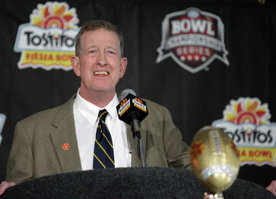 West Virginia coach Bill Stewart answers reporters' questions during a news conference following his team's arrival to Skyharbor International Airport, Wednesday, Dec. 26, 2007, in Phoenix. West Virginia will play Oklahoma in the Fiesta Bowl on Jan. 2.(AP Photo/Paul Connors) Photo: Paul Connors / AP