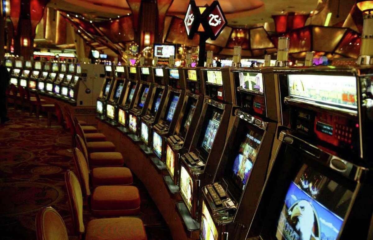 A row of empty quarter slots on the gambling floor at the Mohegan Sun Casino, Thursday, Nov. 19, 2009