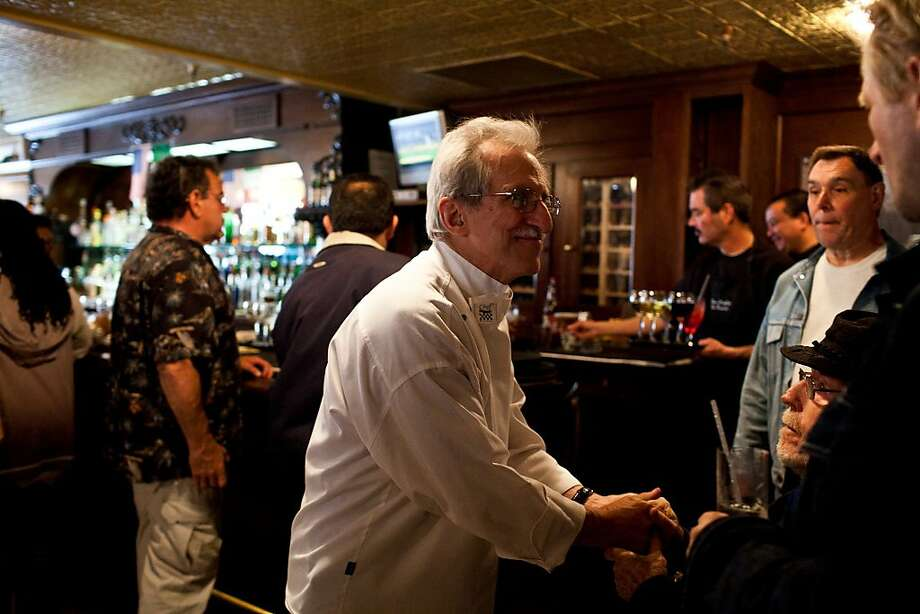 Gianni Audieri, executive chef of Fior d'Italia, greets longtime patrons stopping by to say goodbye. Photo: Jason Henry, Special To The Chronicle