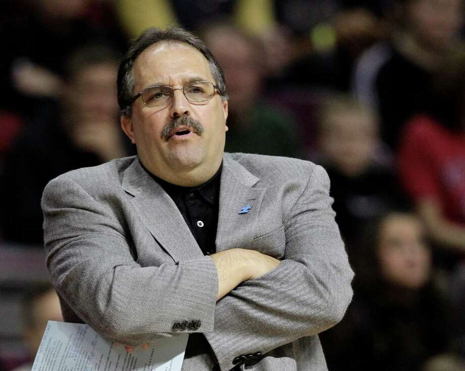 FILE - This April 3, 2012 file photo shows Orlando Magic head coach Stan Van Gundy watching from the sidelines during the first quarter of an NBA basketball game against the Detroit Pistons,  at the Palace in Auburn Hills, Mich. The Magic have fired coach Van Gundy after a rocky season. The moves came Monday, May 21, 2012 after the team's second straight first-round playoff exit. (AP Photo/Carlos Osorio, File) Photo: Carlos Osorio / AP2012