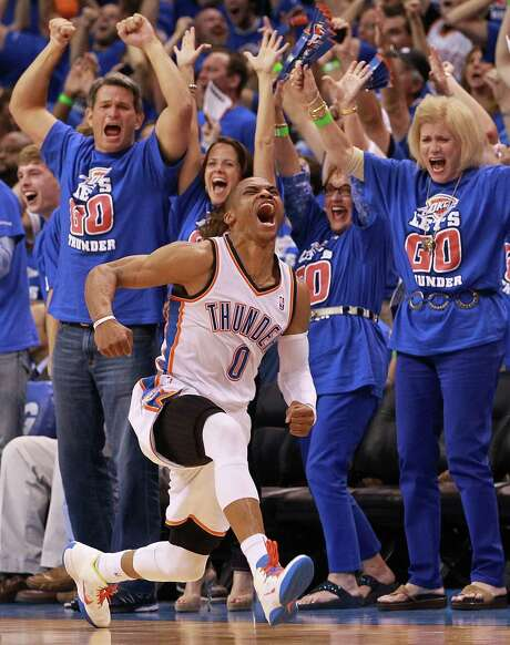 The Thunder's Russell Westbrook is thrilled at hitting an off-balance shot while being fouled. Photo: Ronald Martinez / 2012 Getty Images