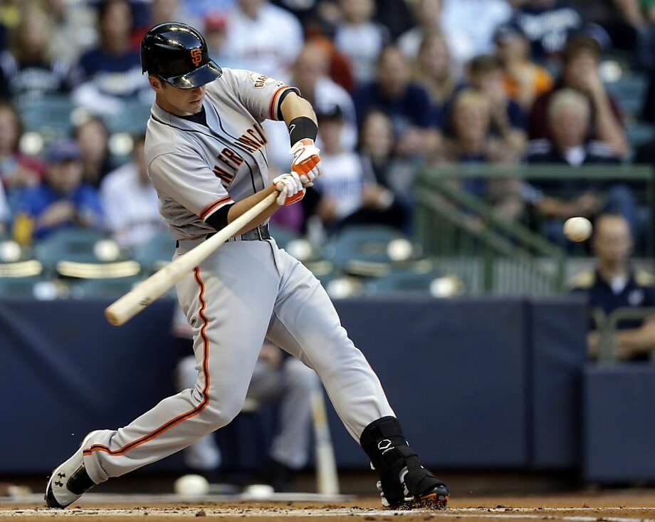 San Francisco Giants' Buster Posey hits a three-run home run during the first inning of a baseball game against the Milwaukee Brewers, Monday, May 21, 2012, in Milwaukee. (AP Photo/Morry Gash) Photo: Morry Gash, Associated Press