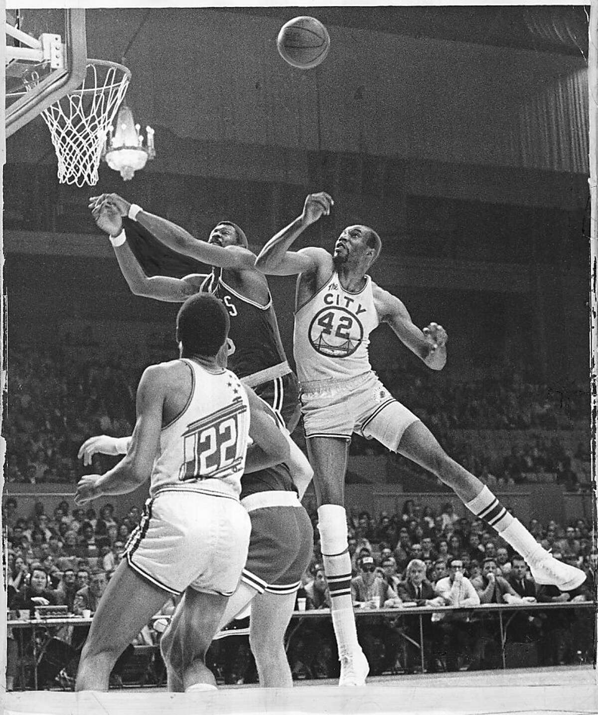 Nate Thurmond battles for a rebound against Boston in 1969. Photo was taken March 21, 1969.