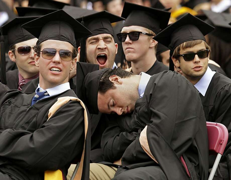 Late night, John? Let's hope John Fiorenzo's classmates wake him up in time for his walk to the podium at Boston College's commencement. Photo: Stephan Savoia, Associated Press