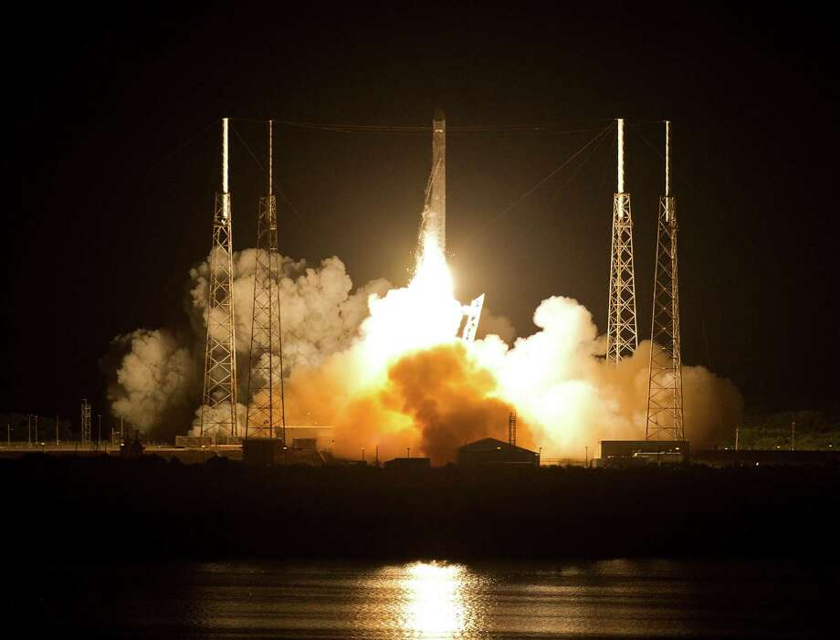 The Falcon 9 SpaceX rocket lifts off from space launch complex 40 at the Cape Canaveral Air Force Station in Cape Canaveral, Fla., early Tuesday, May 22, 2012. This launch marks the first time, a private company sends its own rocket to deliver supplies to the International Space Station.(AP Photo/John Raoux) Photo: John Raoux