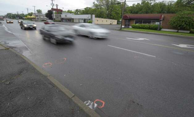 Painted circles on the road are all that remains May 22, 2012,  as police investigate a fatal hit-and-run accident that occurred Monday night near the intersection of Central Avenue and New Karner Road in Colonie, N.Y.  (Skip Dickstein / Times Union) Photo: Skip Dickstein